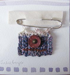 pin brooch purple in packet