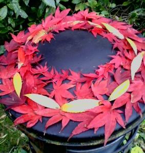 leaves on a park bin