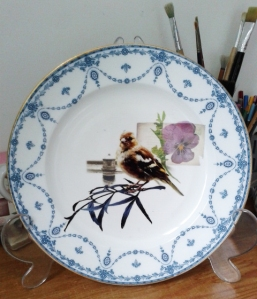 Photo transfer of goldfinch on vintage plate